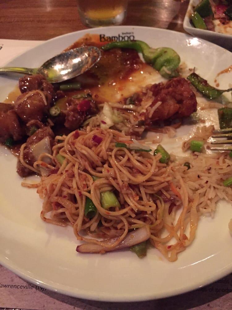 Bland Burnt Garlic Noodles And Szechwan Chicken In A Cookie Cutter Brown Sauce Yelp