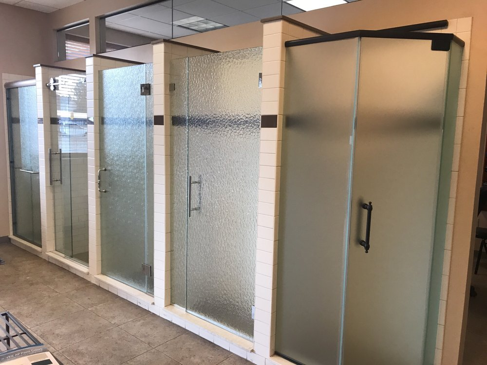 In store examples of shower doors, so pretty!! - Yelp
