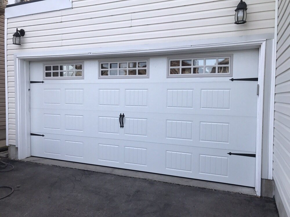 Carriage Style Double Door With Exterior Barn Look Hinges