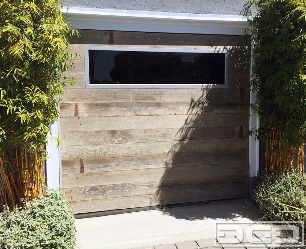 Barn Wood Carriage Doors In A Modern Coastal Cottage