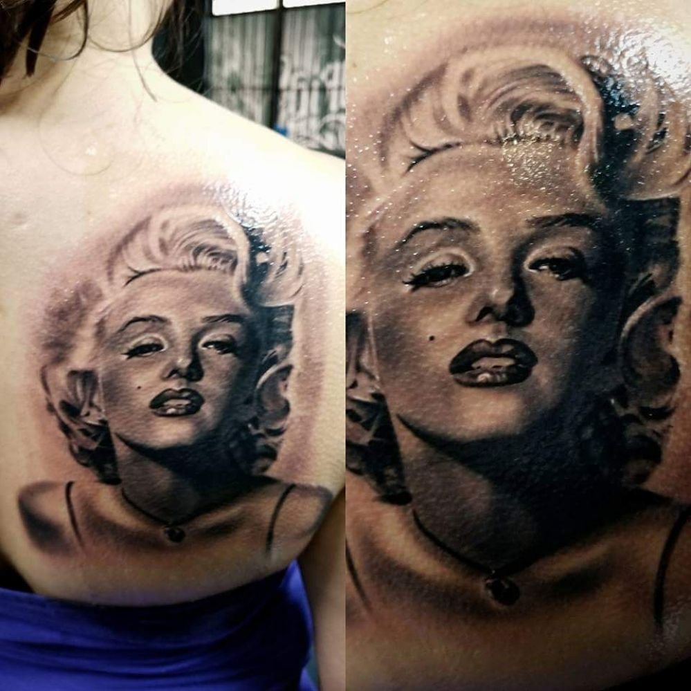f8524ac55 Here is a black and grey portrait tattoo of Marilyn Monroe done by ...