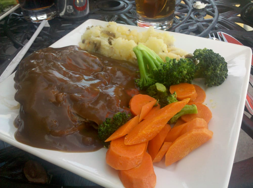 roast beef dinner with gravy, mashed potatoes and veggie ...