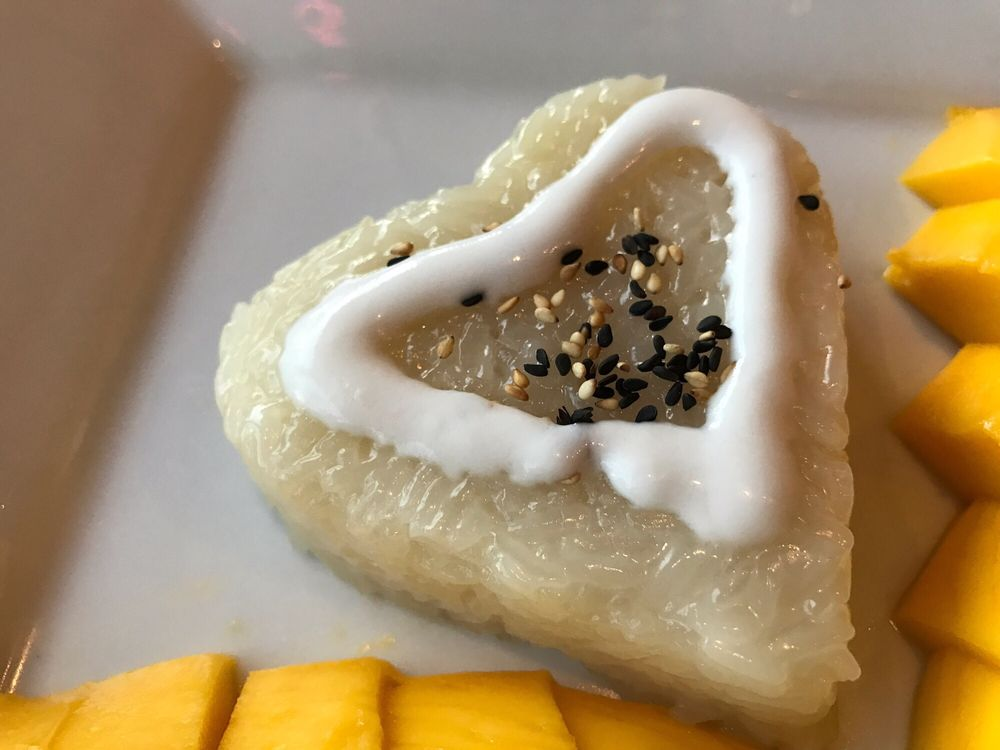 Sticky rice with mango dessert. It's seasonal, when it's ...
