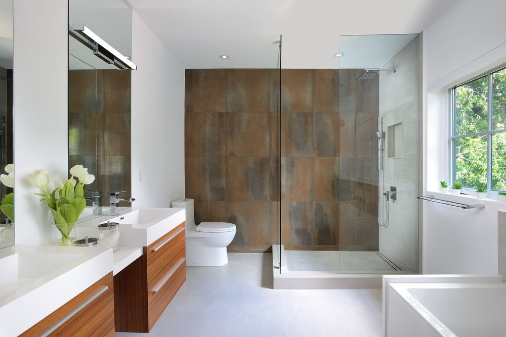 Your shower area can also be the focal point of your bathroom. Apart from using trendy showerheads and bath taps, you can also introduce a feature wall.