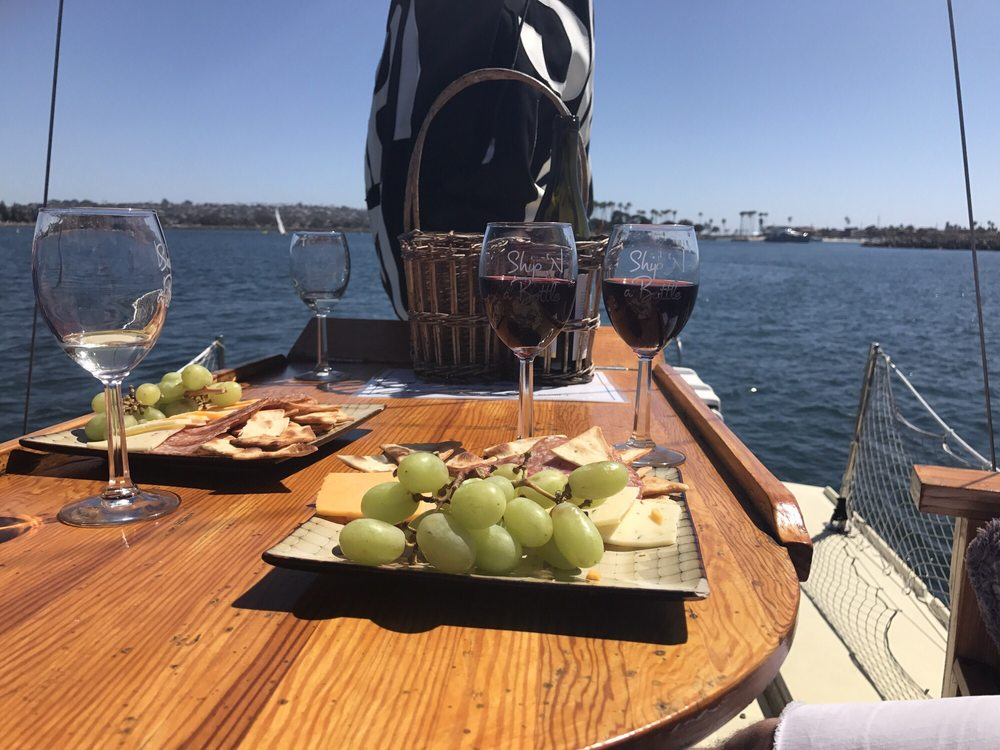Photo of grapes, cheese and wine on a table at Ship N a Bottle - Newport Beach CA