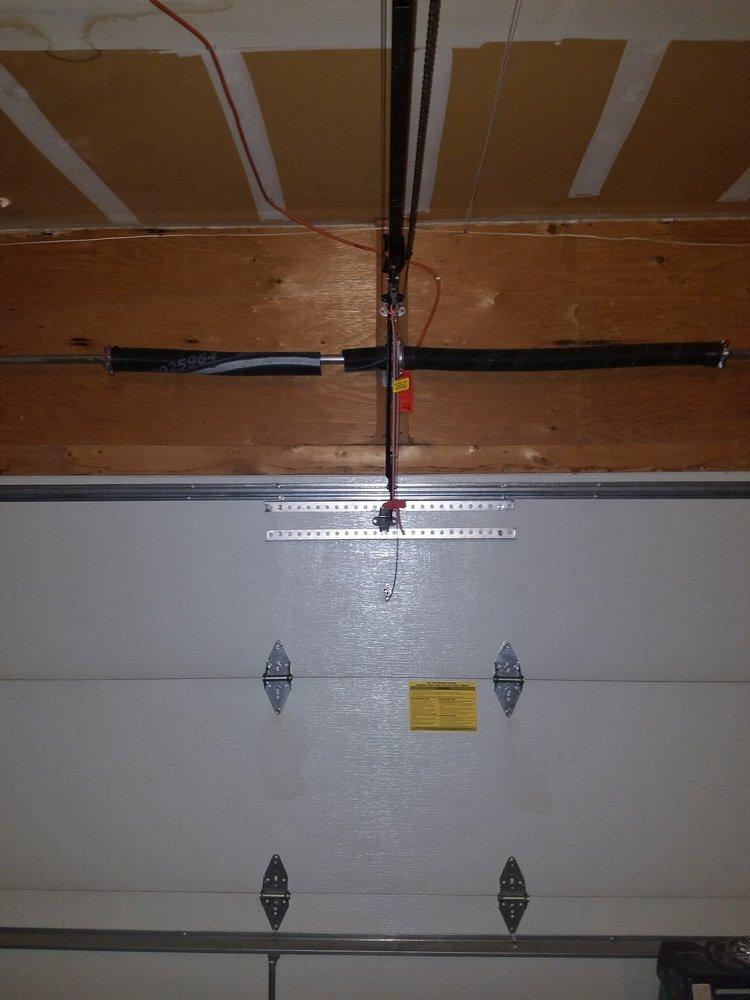 Laughlin garage door 16 foto servizi per porte di for 2 piedi quadrati per garage