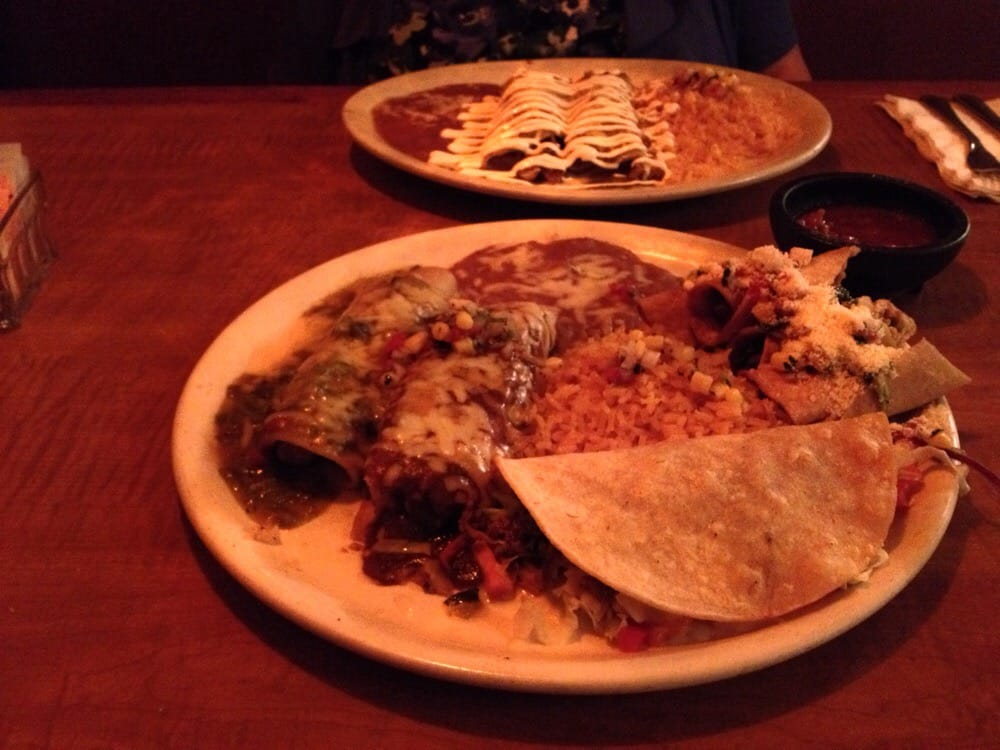Four item combo in front enchiladas suizas in back yelp for Acapulco loco authentic mexican cuisine