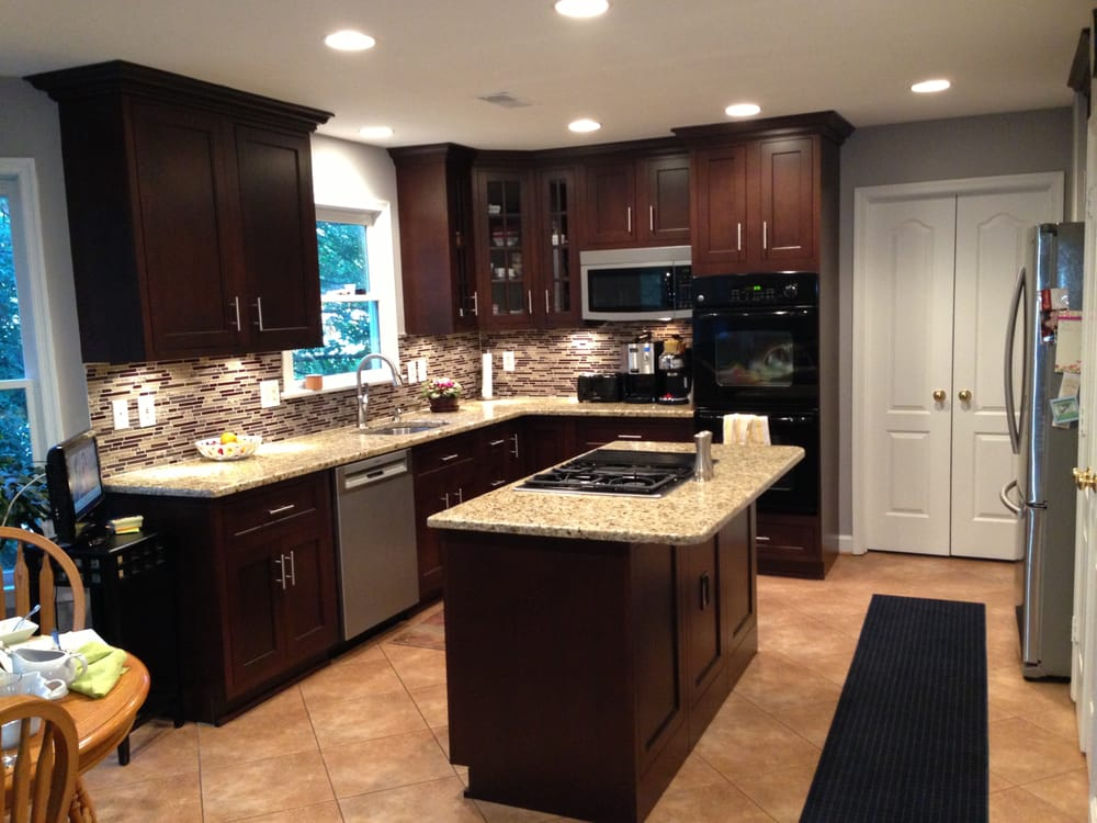 Dark maple cabinets w medium granite and luxury vinyl tile yelp - Black desiner tiels kitchen ...