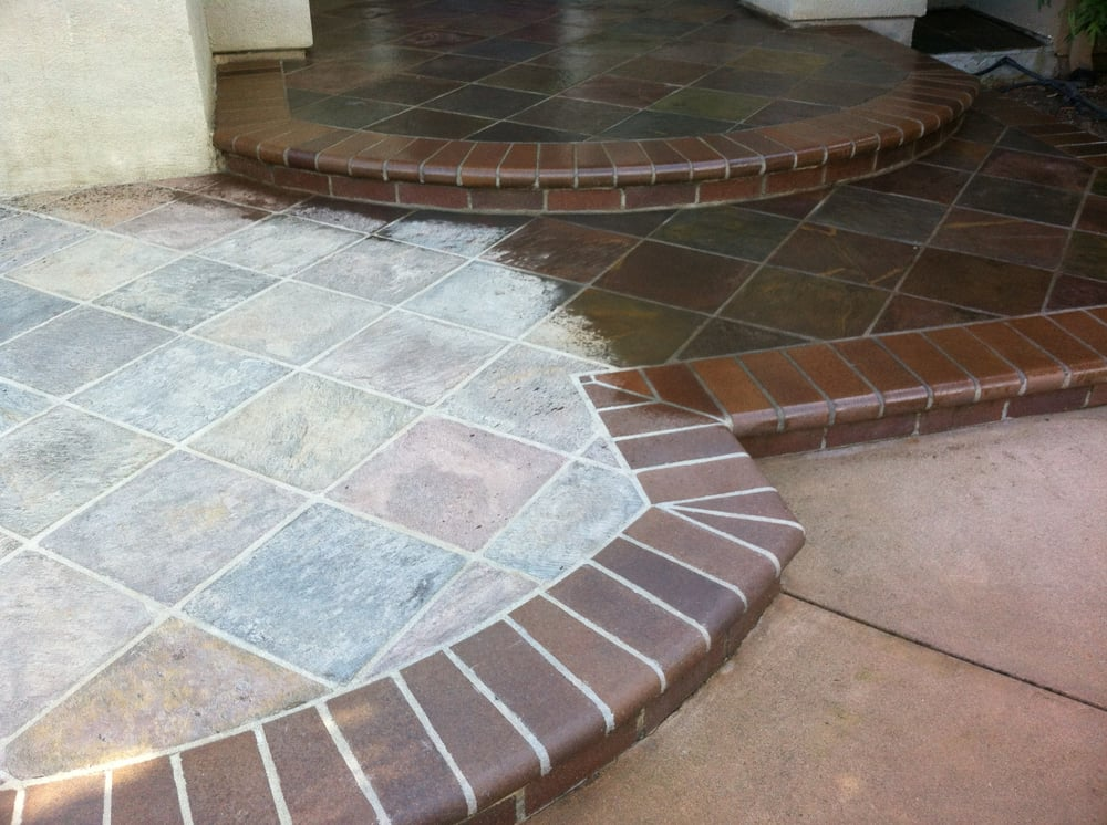 Slate tile with half clean and other half with enhancing sealer