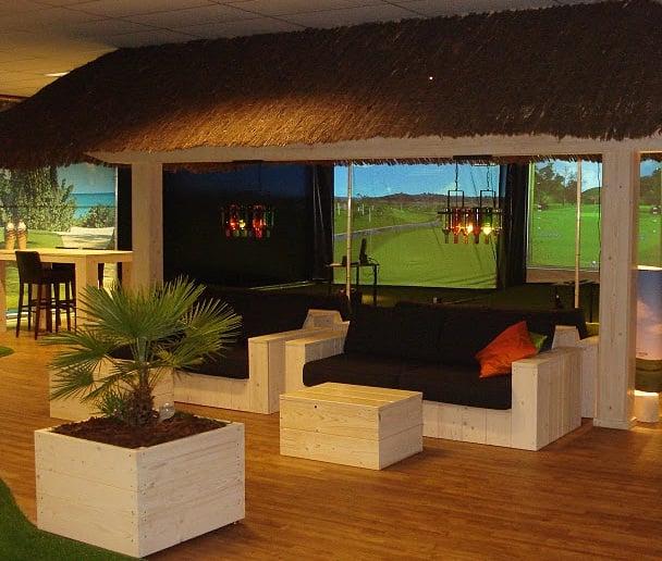 Golf room man cave golf simulator indoor golf yelp for Indoor golf design