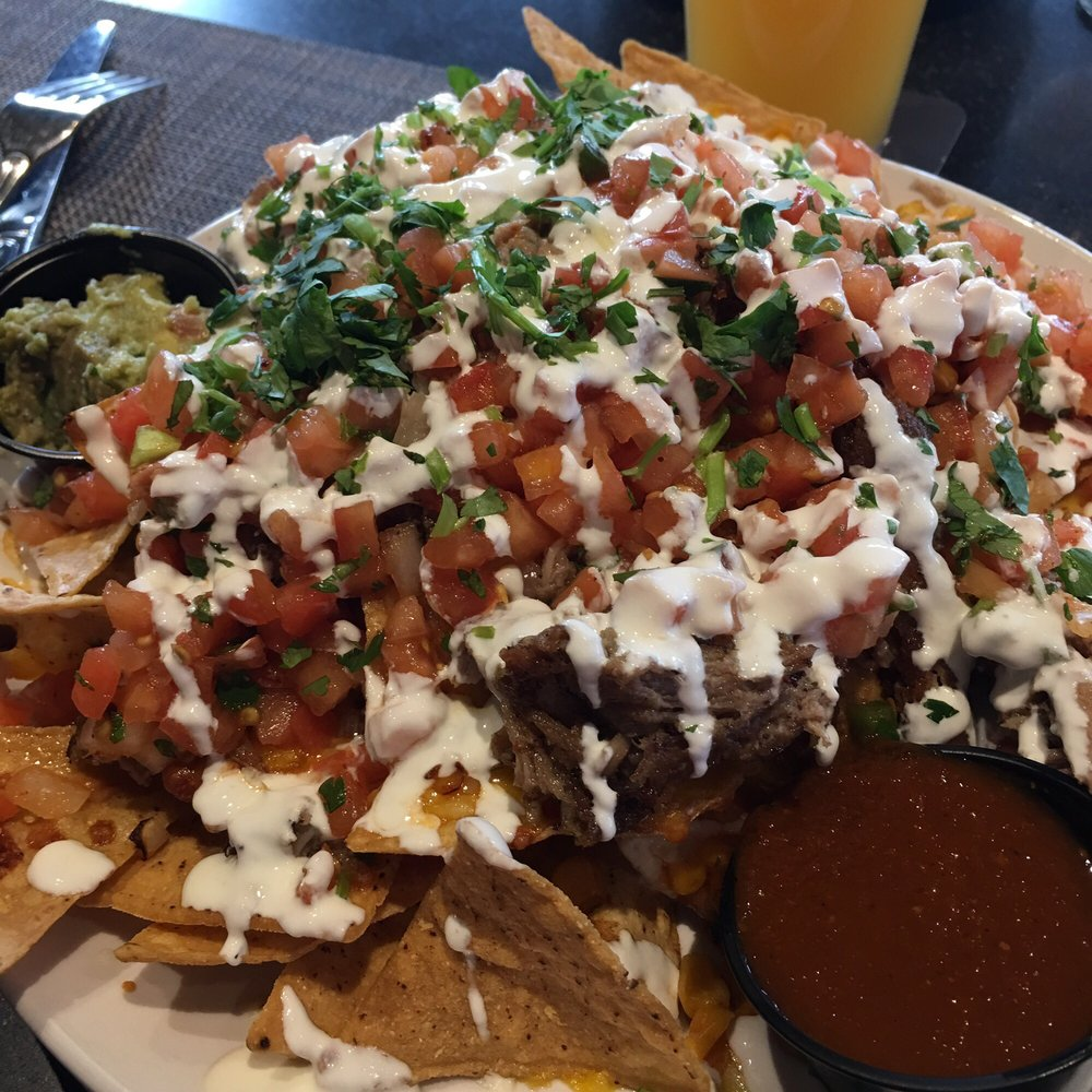 Photo of Central Standard - Bettendorf, IA, United States. Pulled Pork Nachos