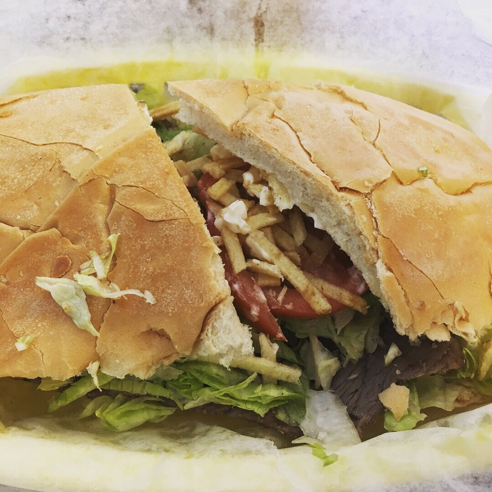 Top 10 best fort lauderdale restaurants for lunch dinner for Prime fish and hoagie