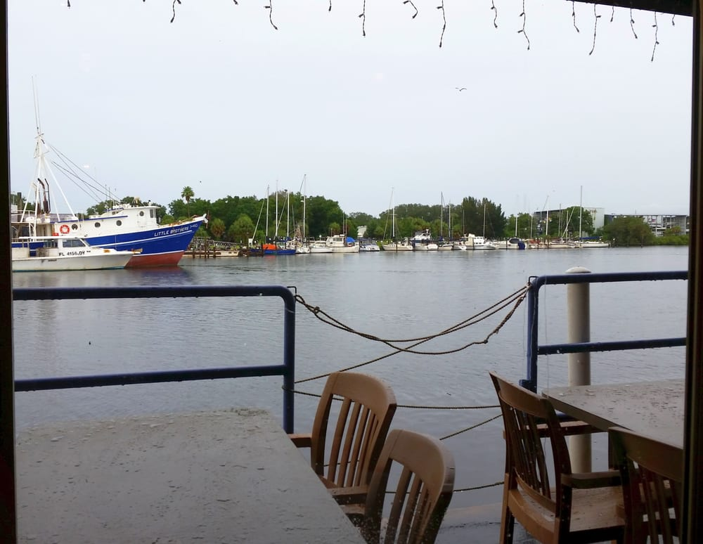 Table side view of the fishing boats in the channel behind for Tarpon springs fishing
