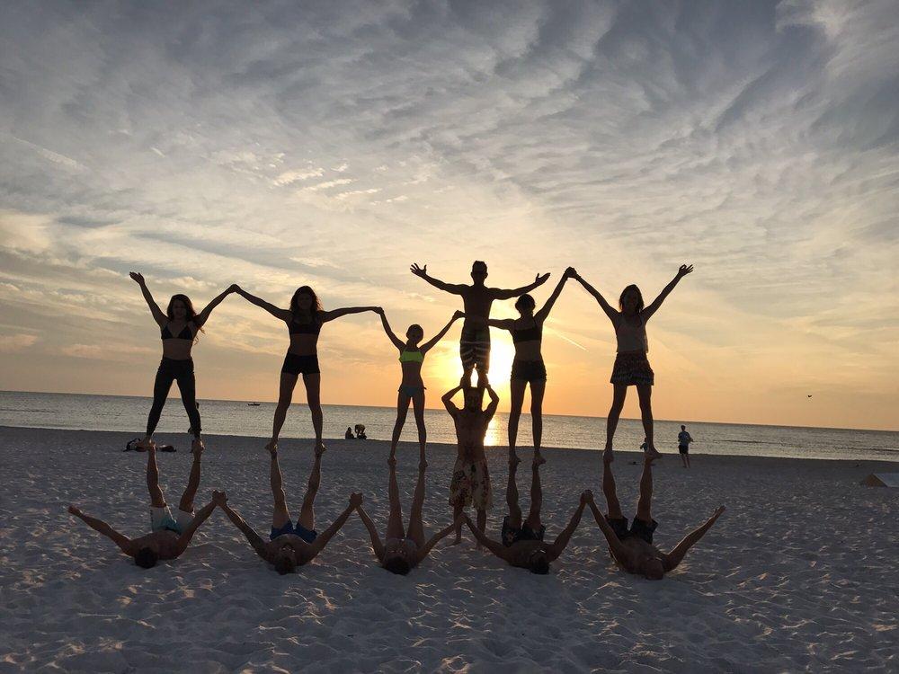 Beach Saint Pete Beach FL United States Friends Doing Acro Yoga