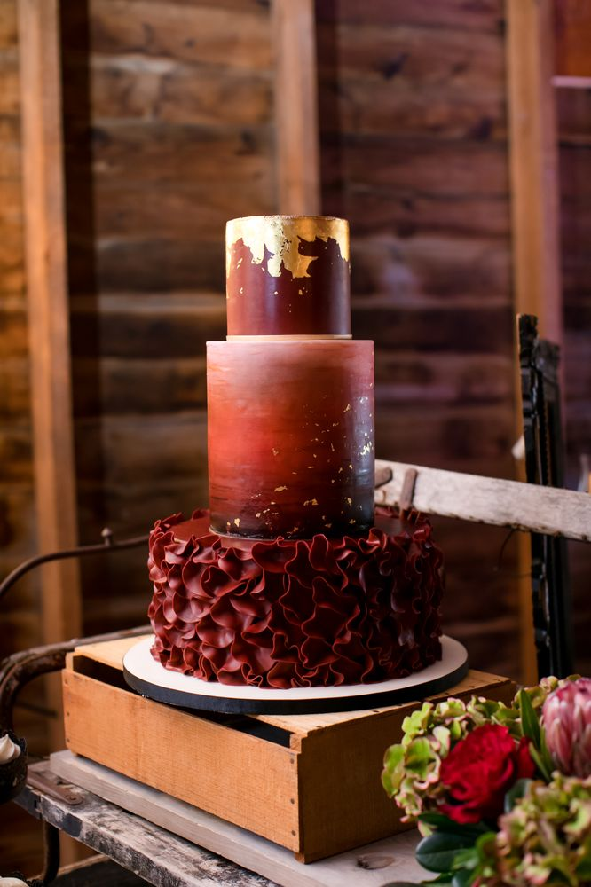 Burgundy Watercolor Wedding Cake With Gold Leaf Accents Photo Credit