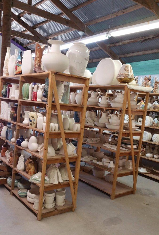 Ceramic Dinos: 247 E Vaughan St, Bertram, TX