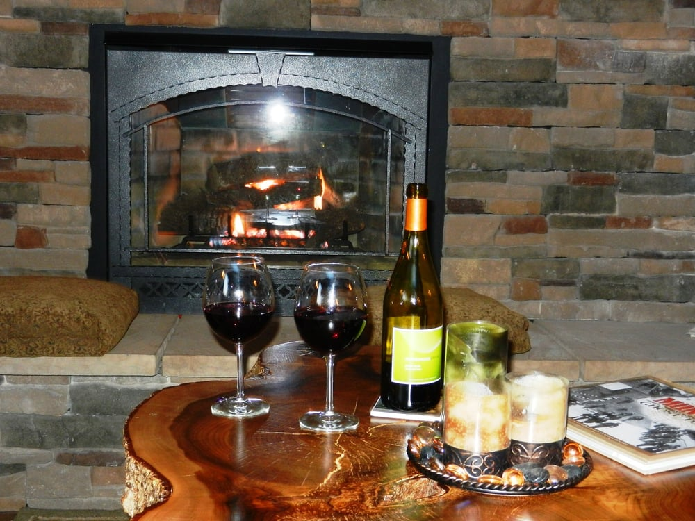 The lodge 39 s beautiful fireplace for relaxing with a bottle for Forest grove plumbing