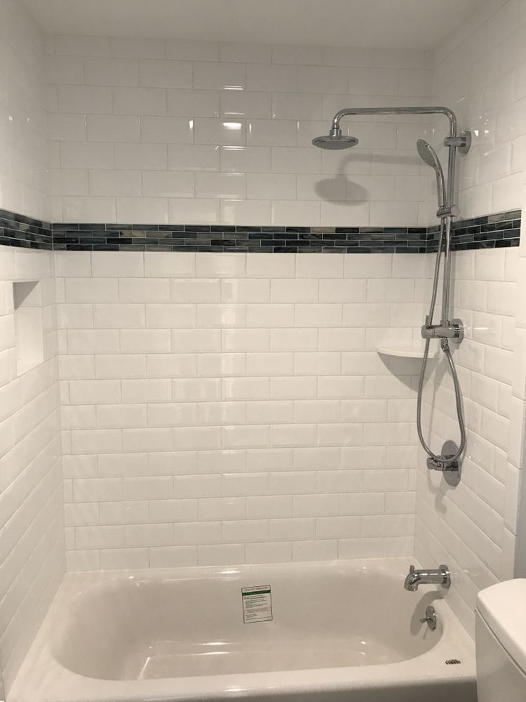 A Kids Bathroom Tub Surround With Beveled X Subway Tile And Glass - Bathroom tubs and surrounds
