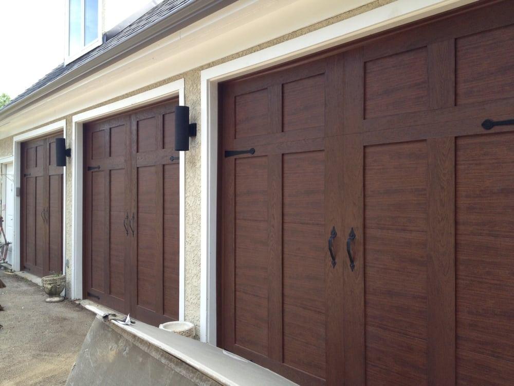 Clopay canyon ridge garage door design 12 solid 9 x 8 yelp for 12x9 garage door prices