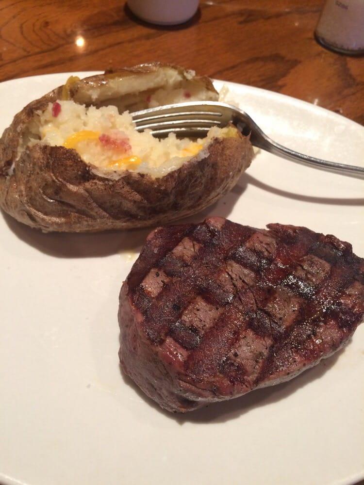Filet mignon medium rare with a baked potato - Yelp