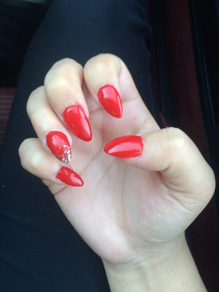 Almond red nails with accent ring fingers - Yelp
