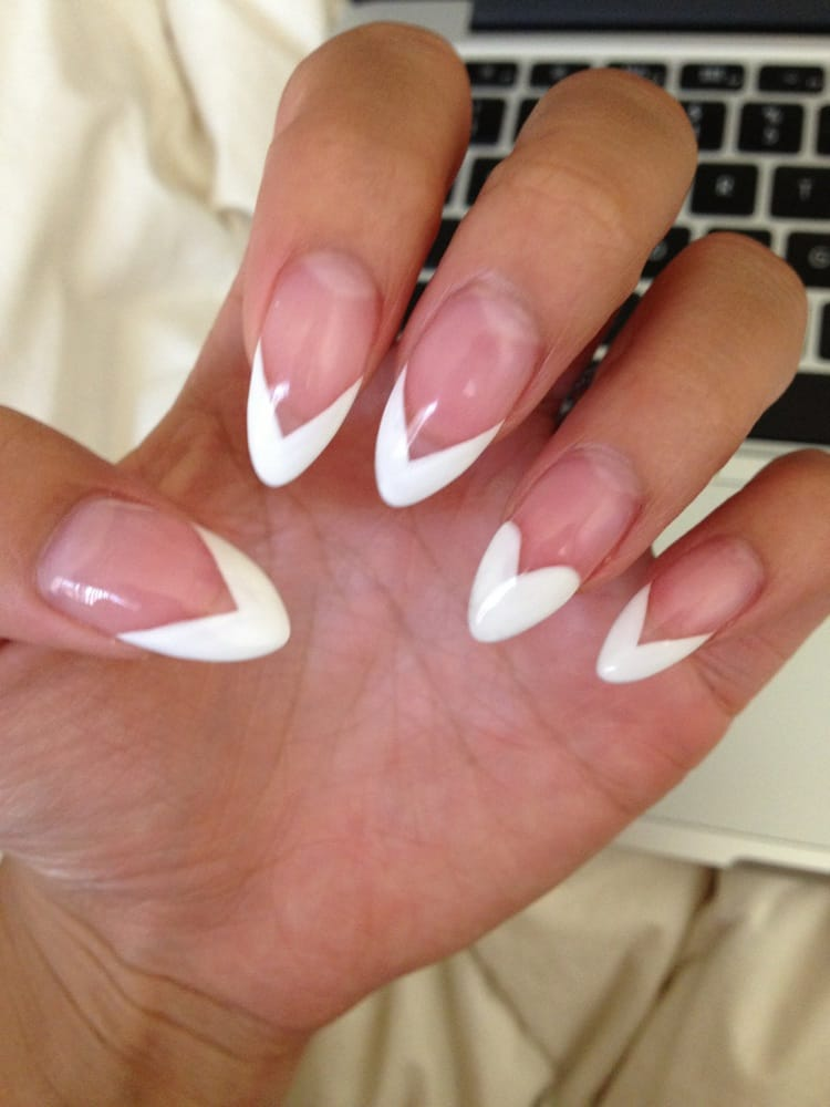 French tips with a heart on the ring finger. Loveee!! - Yelp