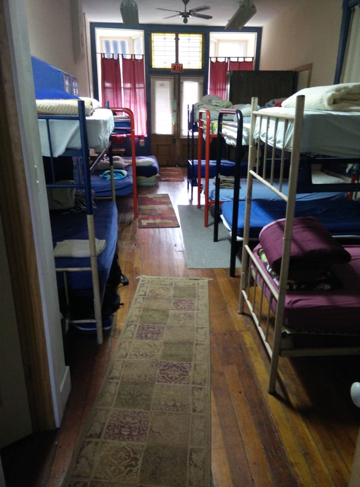 Mens dorm. Bunks are spring hammock style and realllly ...