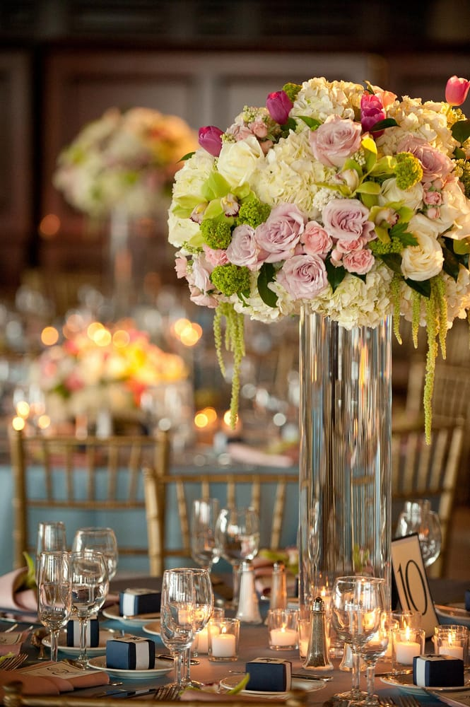 Light pink purple green and white tall centerpiece at the