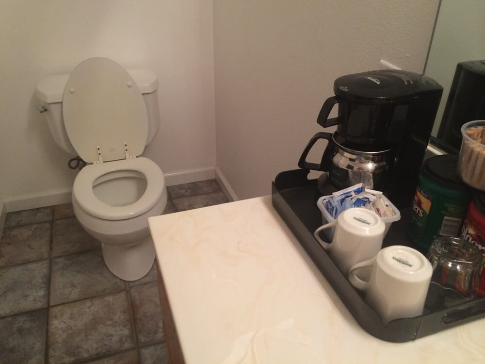 Toilet and coffee maker right next to each other, what a brilliant ...
