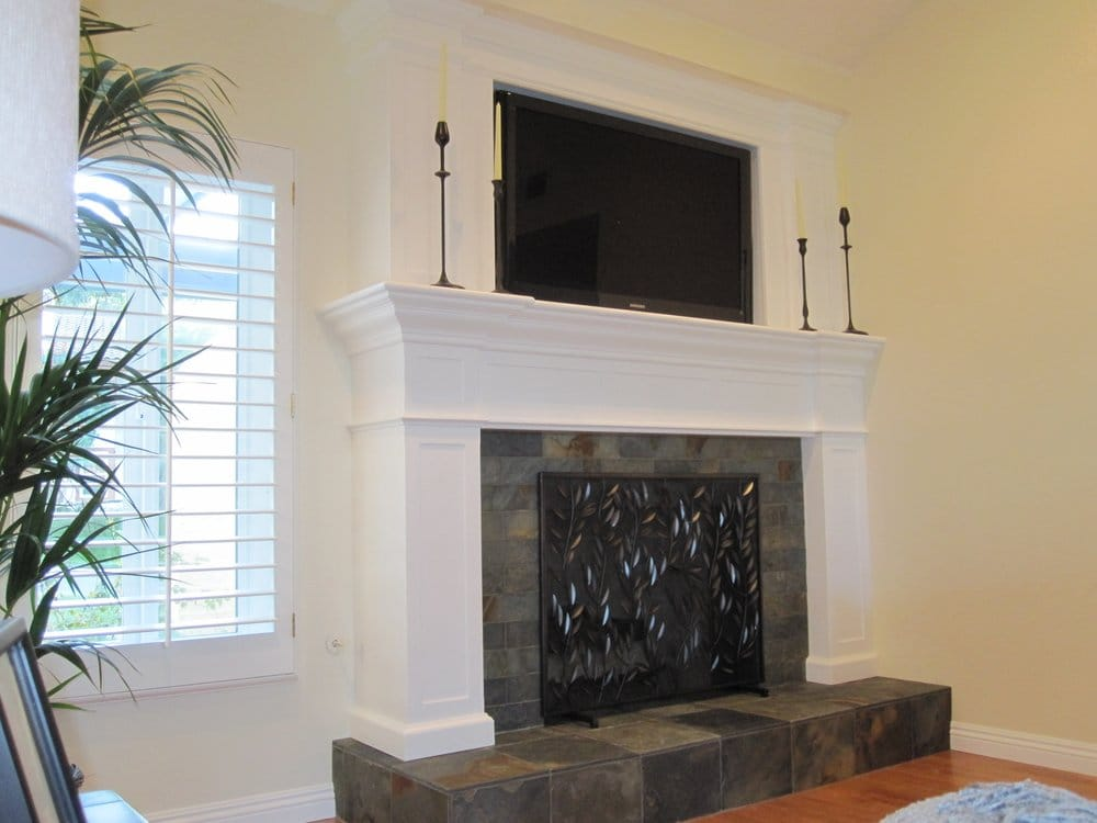 custom wood fireplace with slate tile hearth and inset