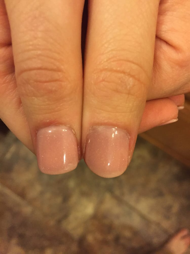 One square nail one round. Didn\'t bother to file my nails evenly. - Yelp