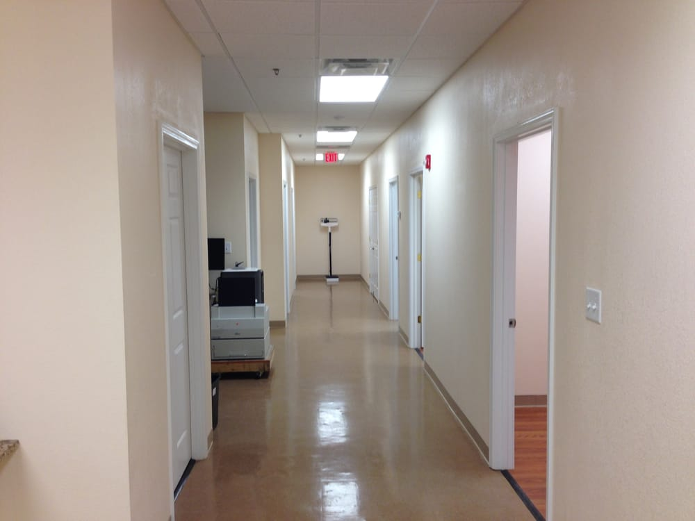 Doctors Office Hallway That Was Freshly Mopped With A
