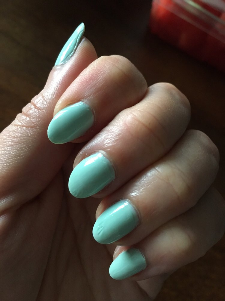 Note the patchy clear coat and rough edges at the cuticles and the ...