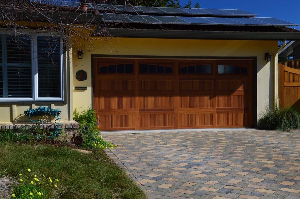 Awesome new steel garage door painted to look like wood for Steel garage doors that look like wood