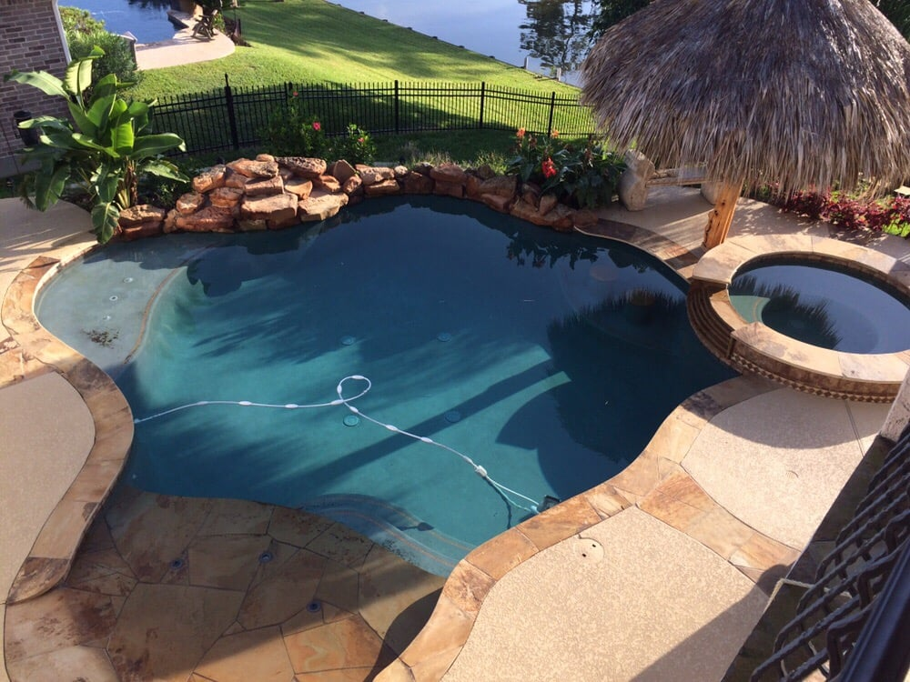 Free Form Pool With Beach Entry And Spa Cool Deck