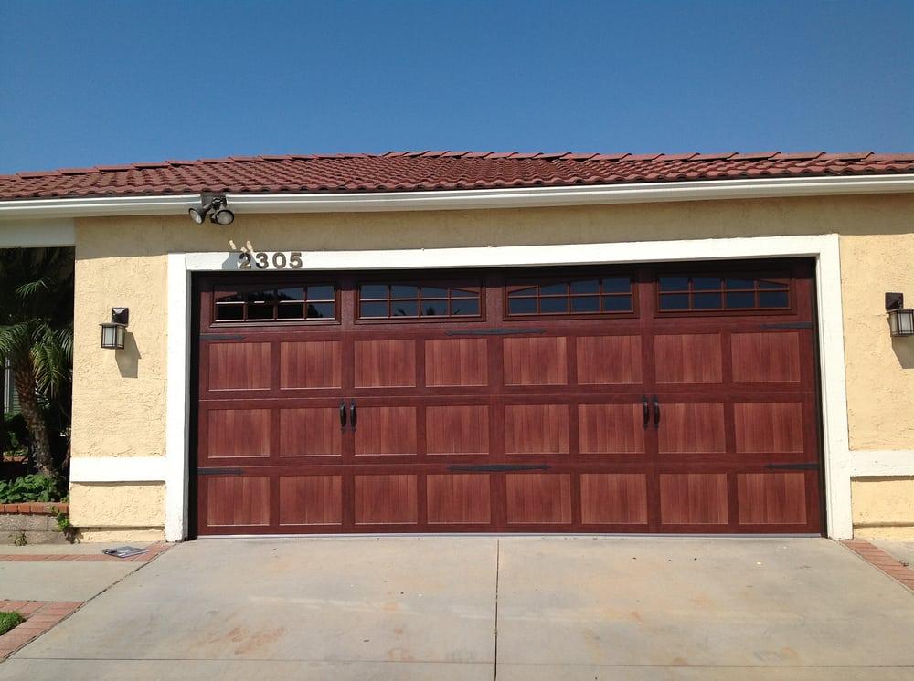 Kim s overhead garage doors 14 reviews garage door for Garage door heights
