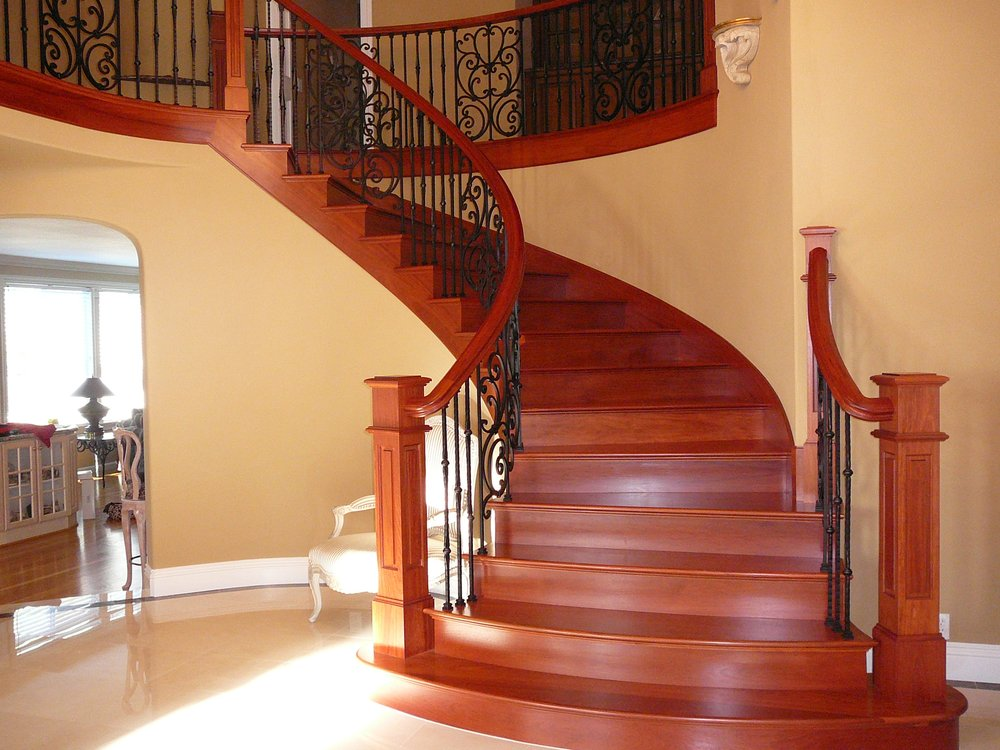 Brazilian Cherry Curved Stair With Iron Balusters   Yelp