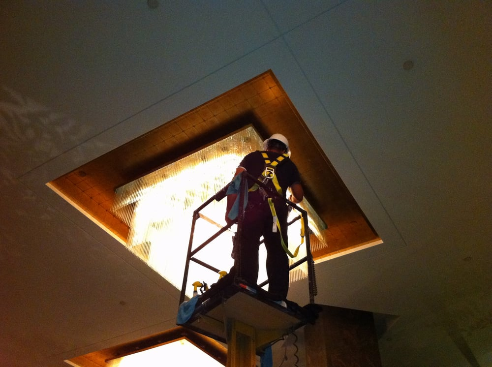 Boom Lift Accessed Chandelier Cleaning In A High Rise