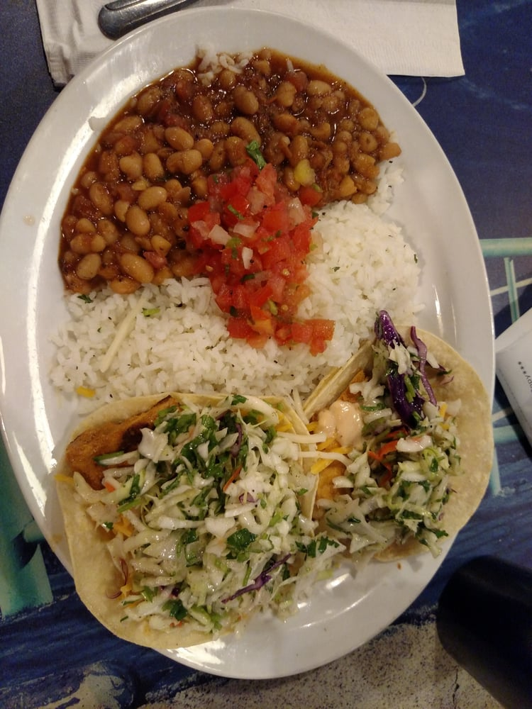 Two spicy fish tacos white rice white beans with for Fish tacos near my location