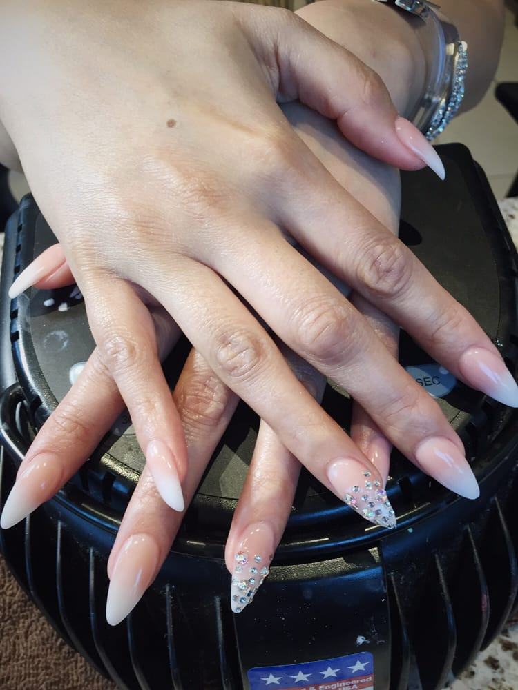 Beautiful ombré stiletto nails using nude and white acrylic powder ...