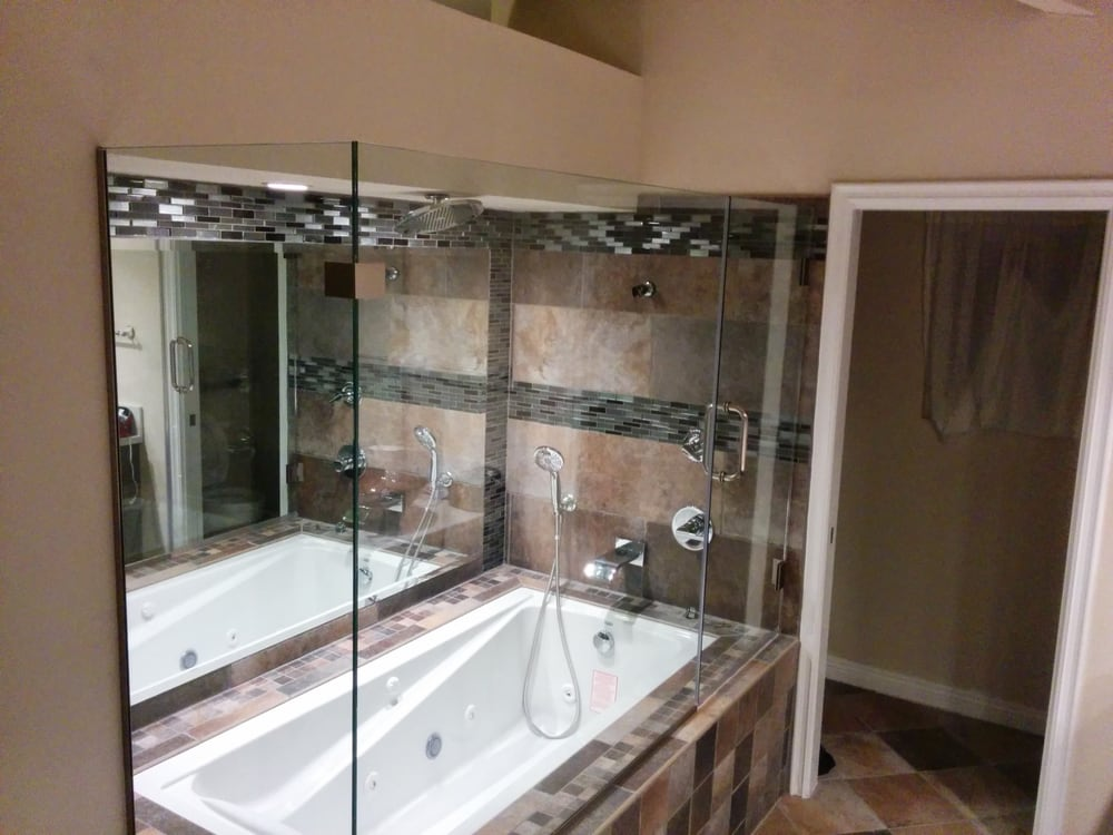 New jacuzzi whirlpool tub and frame-less glass doors. Tiles around ...