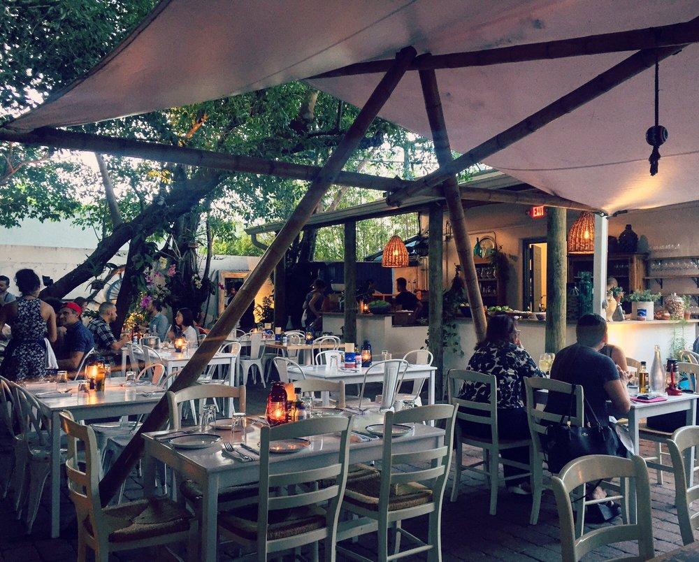 Patio seating is so quaint and inviting despite proximity for Mandolin mediterranean kitchen