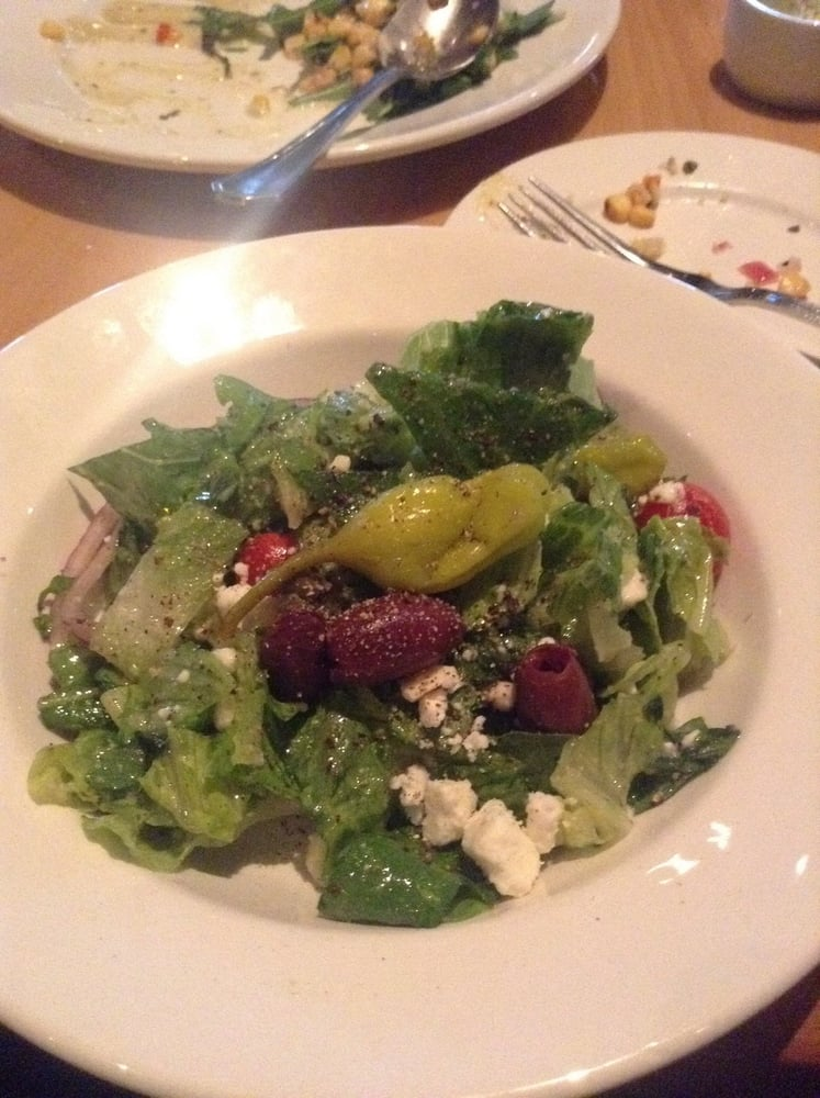 Greek salad with purple olives, feta cheese, tomatoes ...