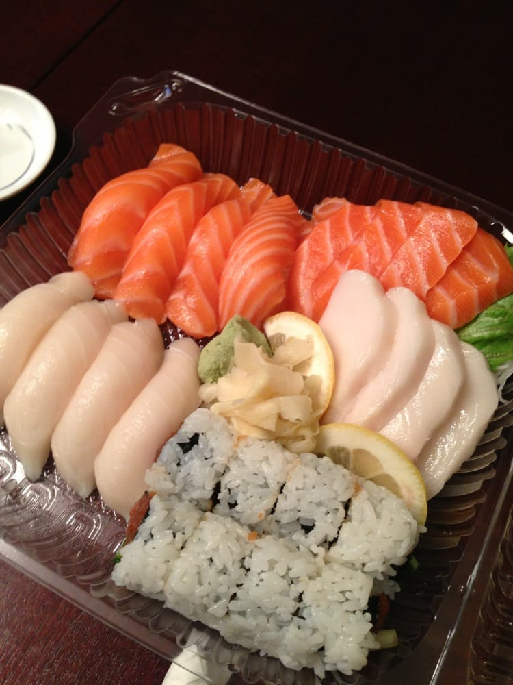 Sake and escolar with spicy tuna roll. Gourmet sushi ...