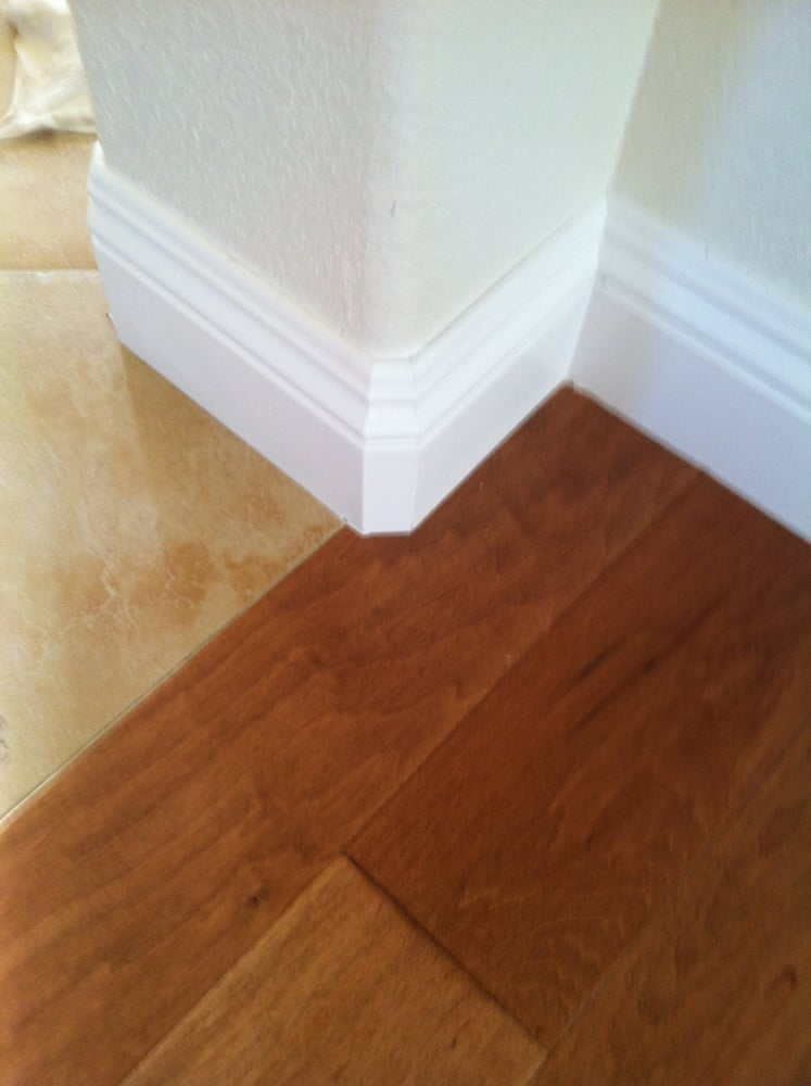 Maple Hardwood Flush With The Tile And The Paint Grade
