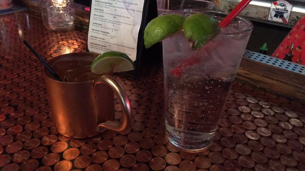 Photo of Sam's Tavern - Seattle, WA, United States. Moscow mule and double gin and tonic