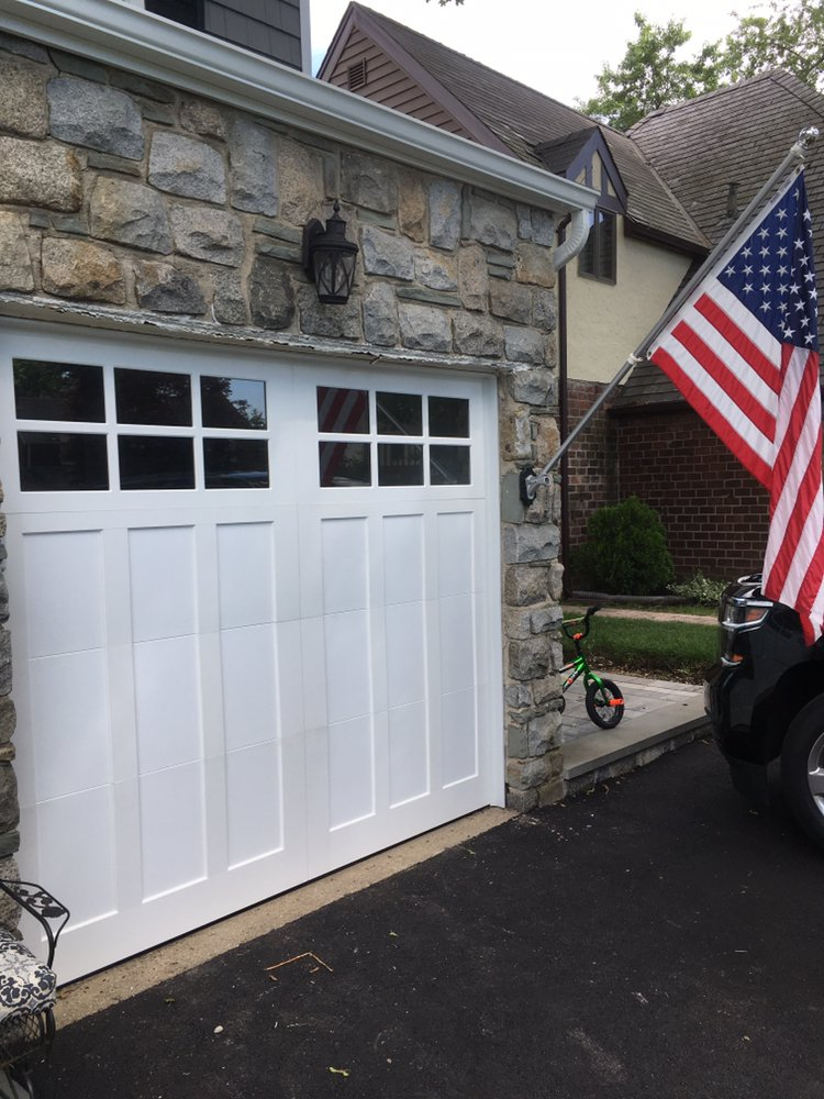 Twin Garage Doors: 9 Guthrie Ct, East Northport, NY