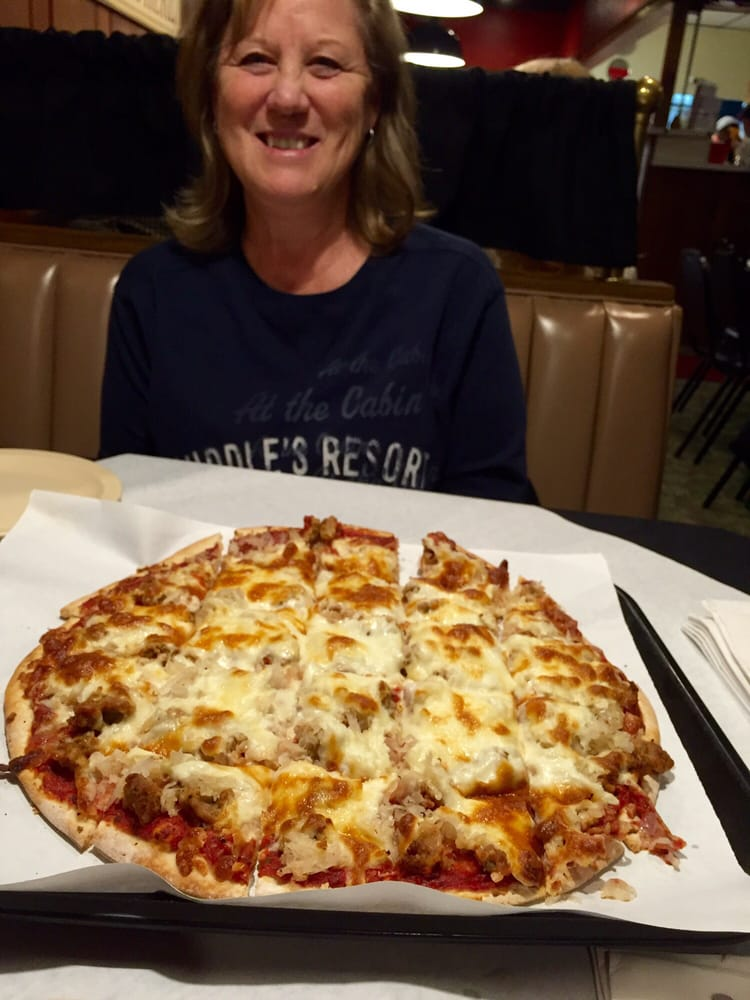 She loves the sausage and sauerkraut pizza. - Yelp