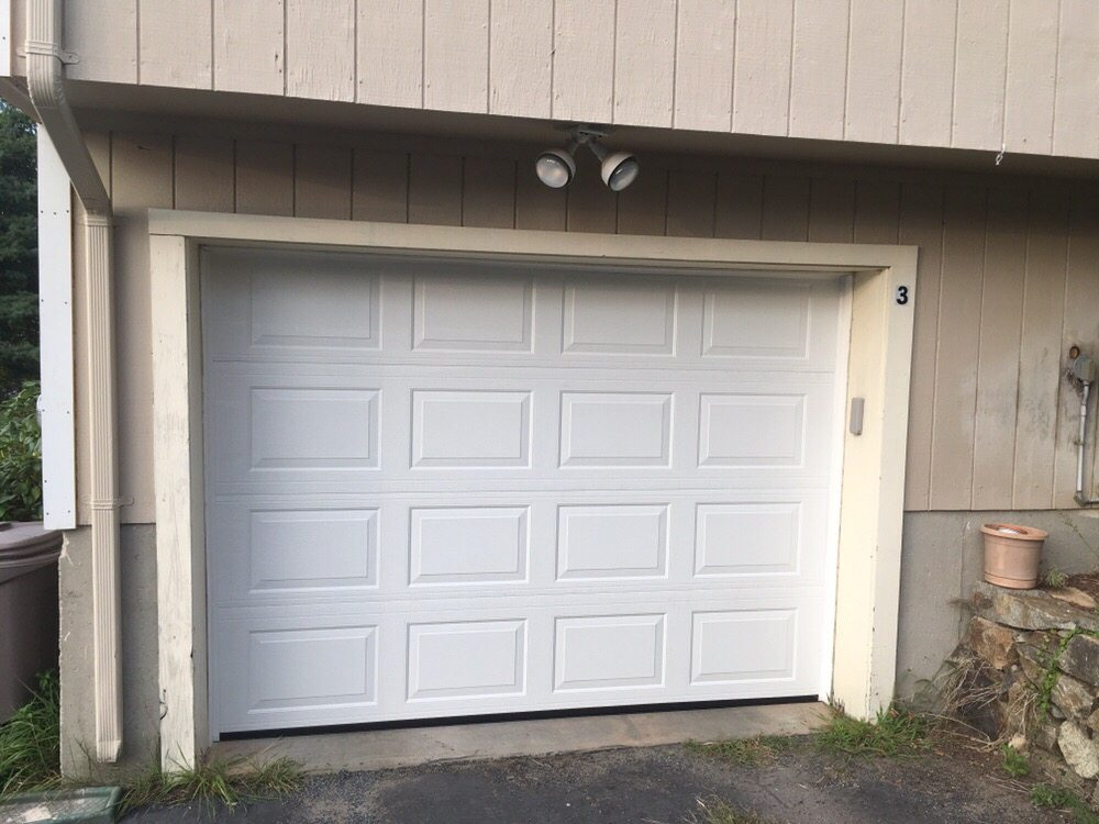 Photo of Shamrock Overhead Door - Norwood MA United States. HAAS Model # & HAAS Model #680 polar white raised panel. Installed 9/17 By ...