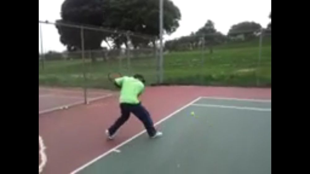 Photo of Tennis Lessons By Mcclain - San Francisco, CA, United States. Racket is back on single backhand knees are bent  Ready to extend arm out to get a complete follow through